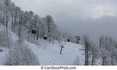 Gondola ski lift in Rosa Khutor Alpine Resort. Time Lapse -...