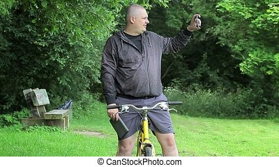 Man on bicycle with tablet PC