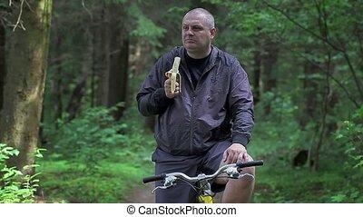 Man eating bananas on bicycle