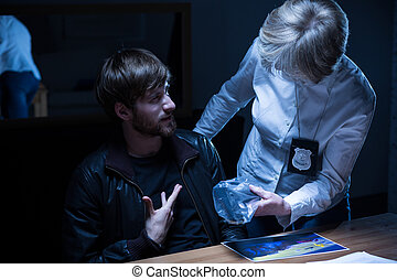 Examination in interrogation room - Bearded man during...