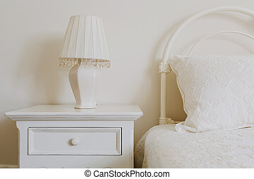 Stylish nightstand next to elegant bed in bedroom