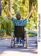 young man in wheelchair relaxed - young man in wheelchair...