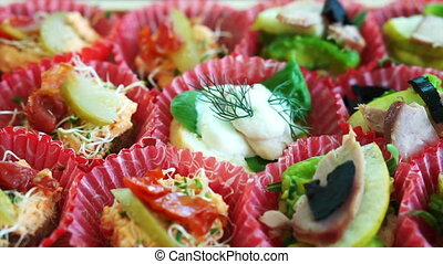 canaps sandwiches at party buffet - Picking finger food,...