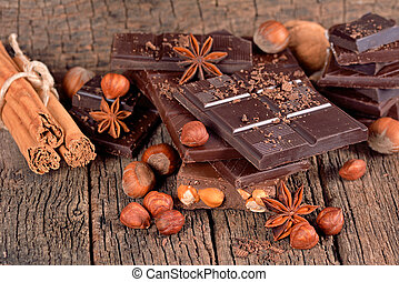 Dark chocolate with nuts on a wooden surface