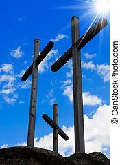 Golgotha - Three Crosses on Blue Sky - Three wooden crosses...