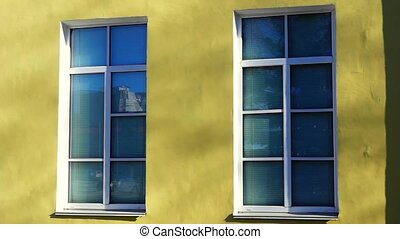 Reflection in two building windows - Reflection of city...