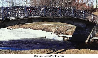 Park river bridge panning in spring