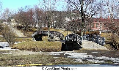 Two bridges in city in spring - Two bridges in city park in...