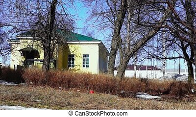 Small yellow building in city - Small yellow historical...