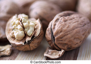 Walnuts - Closeup of an open walnut surrounded by other...