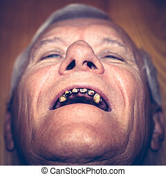 Old man with ugly teeth