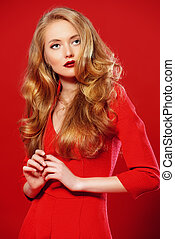 glance - Beautiful young woman in red dress and with blonde...