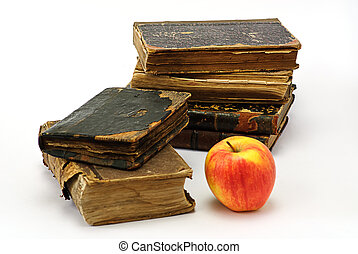 old religious books and apple