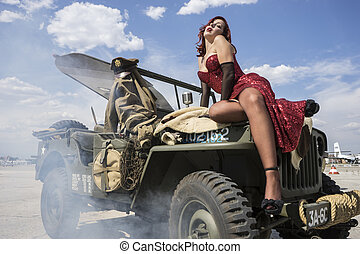 Aviation, pinup dressed in era of the Second World War on a...