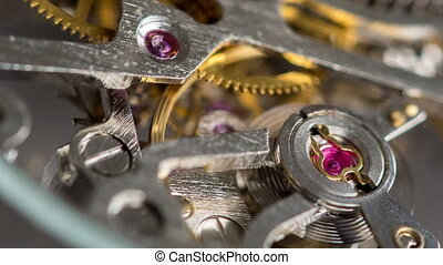 Macro shot of a clockwork - Rack focus macro shot of a...