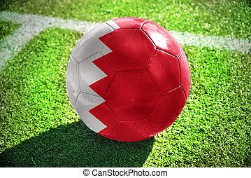 football ball with the national flag of bahrain - football...