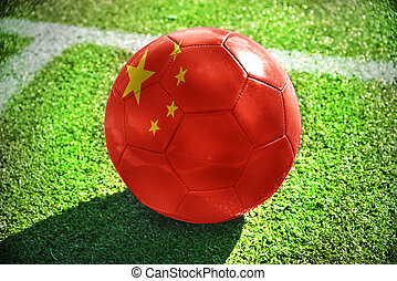 football ball with the national flag of china lies on the...