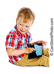boy with a Tablet PC sitting on the floor