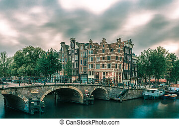 Dusk city view of Amsterdam canal and bridge - Dusk city...