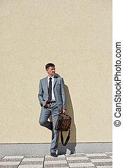 senior businessman outdoors - urban outdoor portrait of...