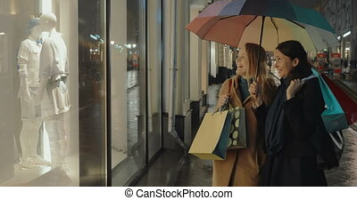 Female Friends in Front of Shops Show Window - Two female...