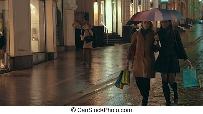 Female Friends Walking after Shopping - Steadicam shot of...