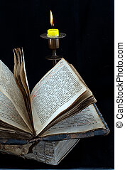 old religious book and candle