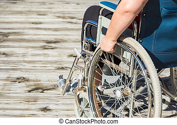 Self Propelled Wheelchair - Woman sitting in self propelled...