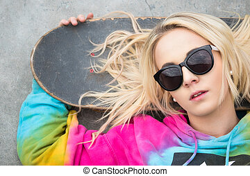 Blond Girl with Skateboard - Pretty blond girl with...