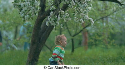 He wants to get these beautiful flowers - Little boy playing...