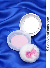 Face powder on blue  background