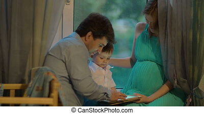 Family Passing the Evening with Tablet PC