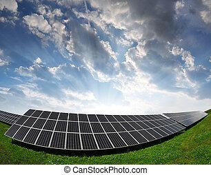 Solar energy panels against sunset sky