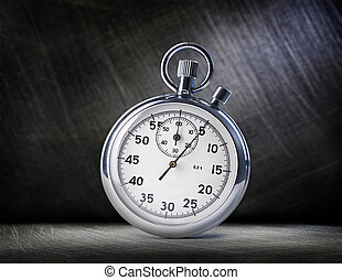 Stopwatch on steel scratchy background in light