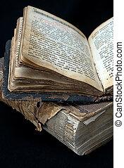 old religious books - old open religious books on black