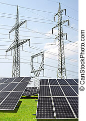 Solar panels with electricity pylons. Green energy concept.