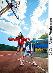 Rapper attitude rap singer hip Hop Dancer performing. Stylish woman and little boy playing basketball