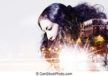 Double exposure of beautiful girl and city lights at night -...