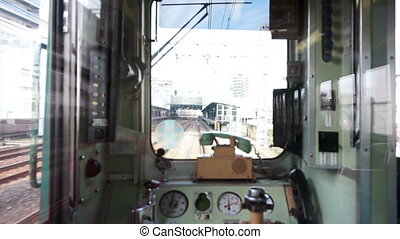 Window of local Japanese train back - View from the back of...