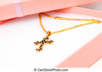 Golden Cross with garnets in packaged