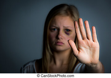 Hand up stop - Abused young girl with hand up to say stop