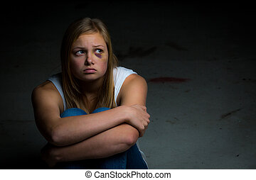Intimidated victim - A young pretty girl and victim of abuse...