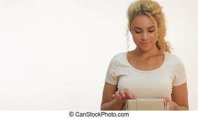 Mulatto girl holding a present in hands