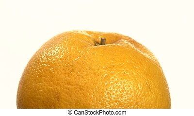 Ripe orange isolated on white, close up, rotation - Fresh...