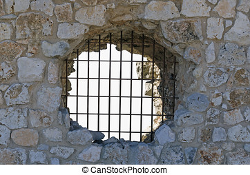 Grilled hole in the wall of the jail - Jail. Grilled hole in...