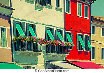 Colorful apartment building in Burano, Italy