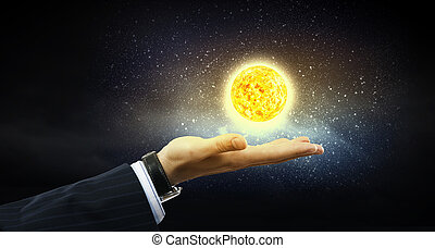 Sun system - Close up of planet sun system in your hand
