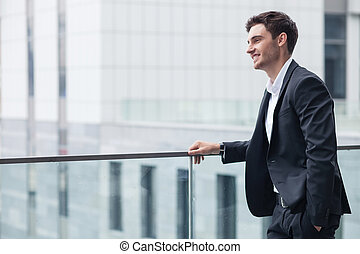 Cheerful young man in suit has a business meeting - Handsome...