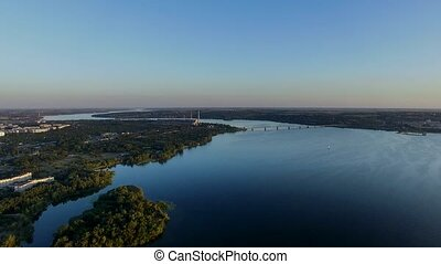 Flying Over The River at Sunset. Aerial Survey - Flying Over...