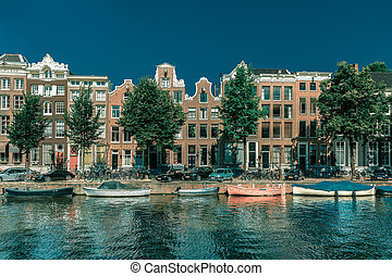 Amsterdam canal and typical houses, Holland - City view of...